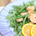 orange garlic shrimp with green beans and aruguala