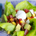 Easy Paleo Taco Salad on blue plate with polka dotted blue fork