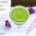 Green Smoothie with purple flowers and pink paper straws