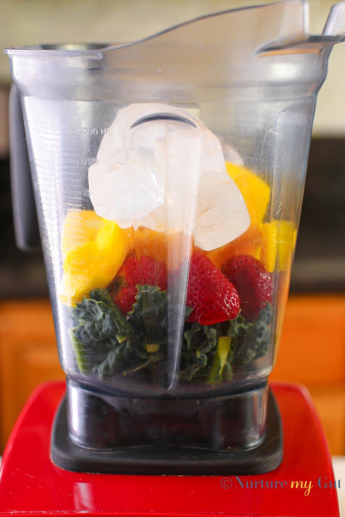 smoothie ingredients in blender with red base