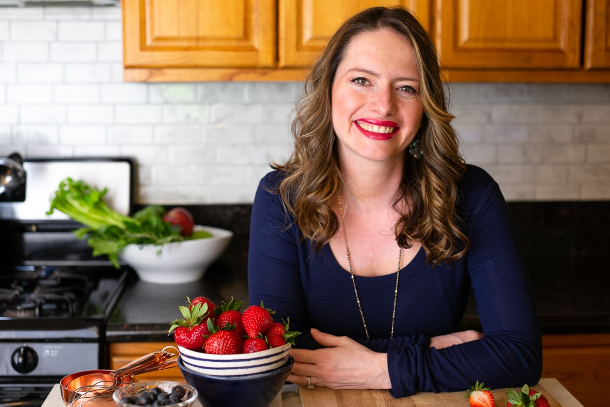 Ester Perez in kitchen with strawberries in bowl