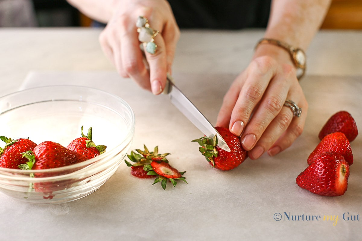 dehulling strawberries with small knife